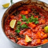 Sweet Potato & Chickpea Curry cooked in a large cast iron pot