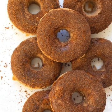 doughnuts stacked with a cinnamon sugar glaze
