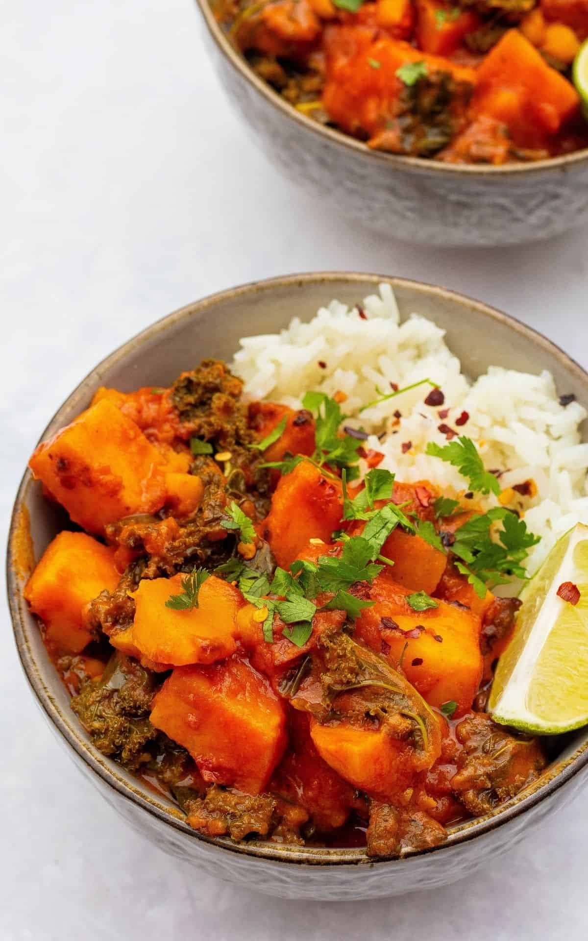 sweet potato & chickpea curry with white rice served in bowls