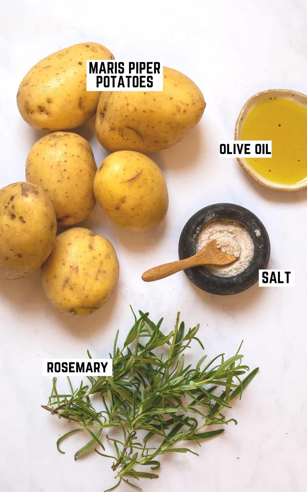 ingredient flatlay for roast potatoes: maris piper potatoes, olive oil, salt, and fresh rosemary