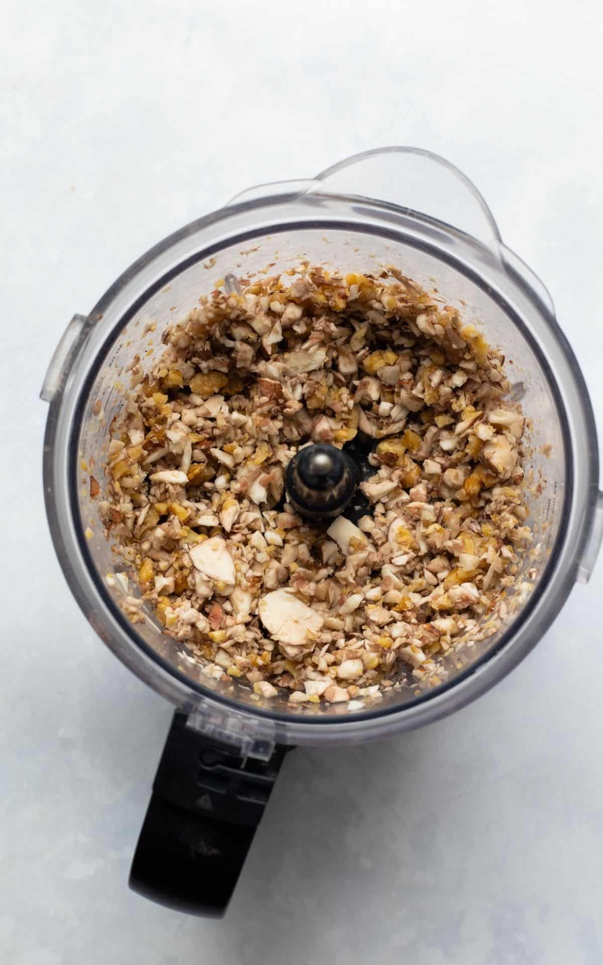 walnut and mushroom mince in a food processor, blended into crumbs